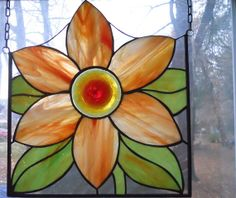 Stained Glass Orange Flower Panehttps://www.etsy.com/listing/172217717/stained-glass-orange-flower-panel?ref=shop_home_feat_3