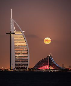 """Better on Black. Full moon rises over Burj al Arab and Jumeirah Beach Hotel, Dubai on 17-Dec-2013.  Pleasure to shoot with Elia Locardi and Bjorn Moerman This is my 8th Photo in 500px Editors' Choice ! Do check out my other  """"Editors' Choice photos""""  or other City & Architecture Photos or see Dubai in a different perspective:  DifferentlyDubai  Instagram 