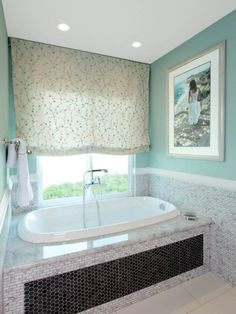 Bathroom- Roman shade that is mostly white with a little teal