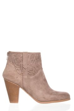"Stop the show in the taupe laser cut faux suede stacked heel bootie Qupid Nixon-35. This taupe booite features swirled laser cut accents, two side pull up straps, almond shaped toe, back zipper, and stacked heel. The taupe laser cut faux suede stacked heel bootie Qupid Nixon-35 has a platform height of 0.25,"" a heel height of  3.50,"" is made from all man-made/vegan materials, and fits true to size."