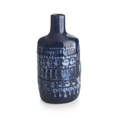 Shop Adalynn Vase.  Reactive cobalt blue glaze pools in this stunning vase's stamped exterior.   Each handmade bottle vase is unique and will vary slightly.