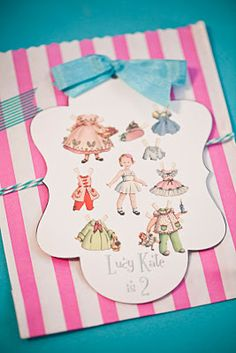 This is another cute paper doll party.  I like the invitation and the cupcakes with cut out toppers.  DH