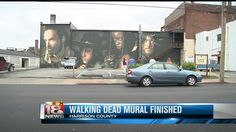 Crowds from all over Kentucky are headed to Cynthiana to take a look at the new Walking Dead mural.  The mural only took about six full days of work to complete.  The co-creator and artist of the c...