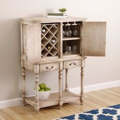 @Overstock.com - Handmade Cottage Wine Bar Cabinet (Indonesia) - Transform your kitchen into an exotic destination with this rustic antiqued wood wine bar. This unique piece holds both bottles and glasses and is handcrafted by artisans in Indonesia.  http://www.overstock.com/Worldstock-Fair-Trade/Handmade-Cottage-Wine-Bar-Cabinet-Indonesia/7662349/product.html?CID=214117 $389.99