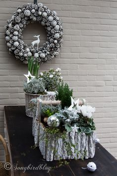 My outside Christmas table decorations - Songbird - - Easy outside Christmas table decorations: containers filled with plants in a winter color palette with added Christmas ornaments. The pretty pine cone wreath fits right in. Natural Christmas, Outdoor Christmas, Rustic Christmas, Winter Christmas, Christmas Holidays, Christmas Wreaths, Christmas Crafts, Xmas, Christmas Ornaments