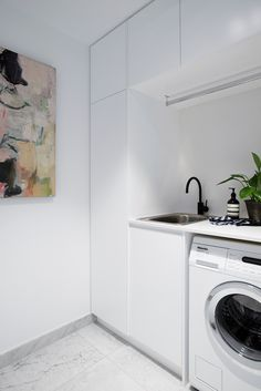 white laundry with artwork Laundry Cupboard, Linen Cupboard, Laundry Room Bathroom, Small Laundry Rooms, Bathrooms, Laundry Room Inspiration, My Ideal Home, Laundry Room Organization, Laundry Room Design