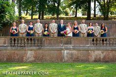navy suit groom, beige suits groomsmen... navy bridesmaids...