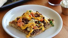 Can't decide between nachos and pizza? This Nacho Supreme Pizza takes only 20 minutes of prep, and combines the best of botch worlds. It's the perfect touch for your Cinco de Mayo Fiesta! Appetizer Recipes, Snack Recipes, Appetizers, Cooking Recipes, Pizza Recipes, Beef Recipes, Hamburger Recipes, Yummy Recipes, Dinner Recipes