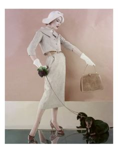 Naughty dachshunds! Vogue US, - February 1957. Photographed by Karen Radkai.
