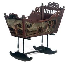 A DUTCH POLYCHROME PAINTED CRADLE ON STAND