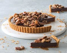 With this decadent tart, less is more. A simple graham cracker crust ensures that the bittersweet ganache and honeyed pecans remain the stars of the show.