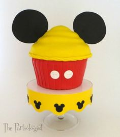 Any Disney fan would love this giant Mickey Mouse Cake made with Rice Krispie treats! The tutorial also features lots...
