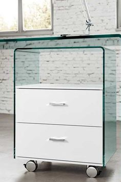 Drawer unit in 8 mm curved transparent glass. The drawers have white lacquered wood frame. The drawer unit features 2 drower with automaatic soft closure system. Chromed wheels and handles. The glass part is available in the following finishes: transparent, extralight, fumé, bronze, nero95 and silver back. #drawer #glass #rialto #fiam #arredaremoderno Chrome Wheels, Drawer Unit, Curved Glass, Modern Glass, Chest Of Drawers, Filing Cabinet, Modern Design, The Unit, Storage