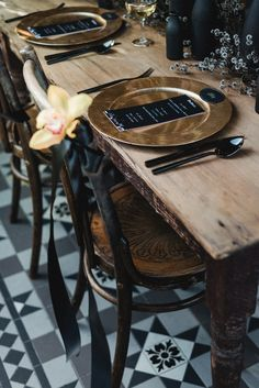 gold tableware for a rustic outdoor celebration