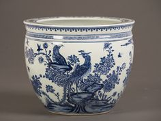 Blue and White Glazed Fish Bowl, China. The curved sides and wide rim of this vessel indicate its use as a container for the display of an exotic fish. The ownership of rare and beautiful animals was a sign of wealth and power in Chinese society.