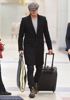 Keeping his head down: David, 40, cut a shy and retiring figure as he strolled through John F. Kennedy International Airport, focusing his attention on the floor