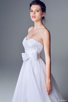 Blumarine 2014 bridal collection Strapless dress with beaded bodice and bow at the waist.