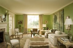 Jean-Michel Frank redux by Nestor Santa-Cruz: Originalparchmenttablesby Frank mix with new upholstered pieces,allsurroundedby bright greenleather-like wallpanels. In Frank's rooms, color was either absent or shocking. As a nod to the 1930s, MatisseandCocteaudrawings hangabove thesofa.