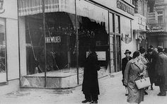 This picture shows the the night of Nov 9, 1938, also known as the night of broken glass or Kristallnacht. This was the night where Jews and their property/shops were attacked throughout the the German Reich. It was a turning point for Hitler's Germany and the first time Jews were physically attacked instead of psychologically.