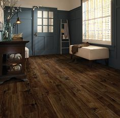 Charming classic country elegance: navy and cream set against dark maple flooring (by Moduleo.)