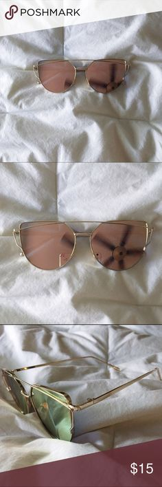 Pink Cat Eye Sunglasses! pink and gold cat like sunglasses! The glasses are a pinkish reflection and in some of the pics it looks blue & green, so at different angles it changes! Brand new and never worn, but it didn't come with tags! Accessories Sunglasses