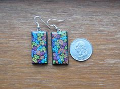 Handmade Polymer Clay Earrings with colorful floral design.