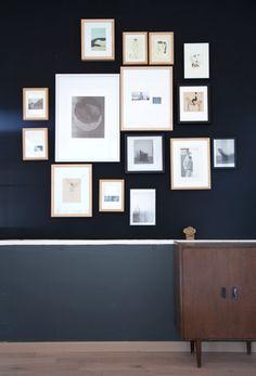 Gallery wall. Dark.