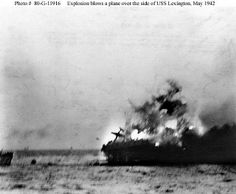 A heavy explosion on board USS Lexington CV-2 blows an aircraft over her side 8 May 1942