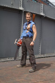 ashley ash j williams from evil dead 1 i made the harness and belt for the heros boomstick chris brings the rest of the costume to life with the