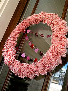 wreath made with cupcake liners- but I would make heart shaped wreaths instead