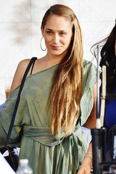 While filming Girls in New York on July 30th, actress Jemima Kirke was spotted doing her best Grecian Goddess impression. Kirke wore an olive draped asymmetrical dress with large hoop earrings and long hair cascading as she got into character playing Jessa for the Brooklyn based HBO show.