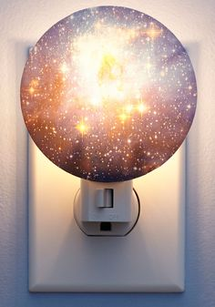 - Realistic 3D printed photo of the Galaxy - Great for children's bedrooms or dark hallways - Manual on/off switch - 7-watt bulb included - Measures approximately 4 by 3.5 by 2.5-Inch