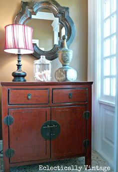 from the blog eclectically vintage a beautiful chest and decorative items greet visitors