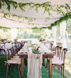 An example of the runner on the farm tables with the chairs. We would use more color, again, so that this evening doesn't come off as wedding-y.