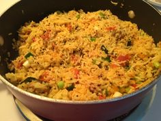 Naz Home Kitchen — Vagahrela rice.  Left over rice stir fried with...