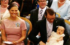 Princess Estelle is a wee bit bored at her christening...