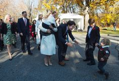 Hadrien Trudeau runs into his father's arms as prime minister-designate Justin Trudeau, his wife Sophie Gregoire-Trudeau, holding daughter Ella-Grace and their oldest son Xavier arrive at Rideau Hall with Trudeau's future cabinet to take part in a swearing-in ceremony in Ottawa on Wednesday, November 4, 2015. (Sean Kilpatrick / THE CANADIAN PRESS)