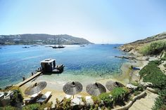 The clear waters of Ornos bay lapping at the gently sloping private beach of Kivotos Mykonos Hotel