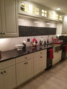 Hampton White cabinets with Black Pearl granite in this great new basement in Independence, Mo.