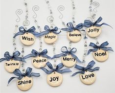 """Beach Christmas ornaments with sweet old-fashioned happy holiday words.  Sweet words like Joy and Twinkle adorn these pretty hanging ceramic disk ornaments. Choose from 11 different words all strung with crystal beads and pearls.  These nautical coastal ornaments are about 1.75"""" around, solid ceramic, rustically stamped in black ink, and hang from gorgeous glass and crystal beads. The beading portion is around 6"""" and we include an """"S"""" shaped silver hanger and a wired blue metallic ribbon…"""