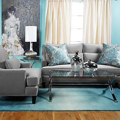 Grey couch with turquoise accents