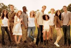 The cast of The Hunger Games in Concord, North Carolina. From left: Isabelle Fuhrman, Jack Quaid, Jacqueline Emerson, Dayo Okeniyi, Leven Rambin, Alexander Ludwig, Amandla Stenberg, Josh Hutcherson, Jennifer Lawrence, and Liam Hemsworth.