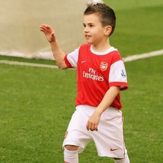 """Wenger introduces his latest purchase. """"He has great potential"""" Wenger said."""