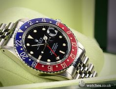 Rolex Vintage GMT Master Watch - Ref 16750. Not often seen on a jubilee bracelet. Black tritium dial dated November 1987. We Buy and Sell Vintage Rolex GMT Master Watches. Contact Us - www.watches.co.uk