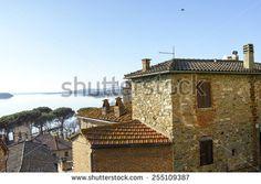 Clock tower in Passignano sul Trasimeno, small town on the homonym lake in the italian region of Umbria. - stock photo