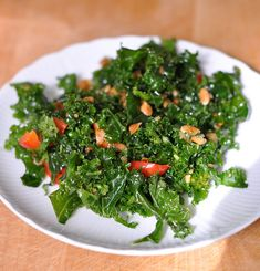 Kale Slaw with Peanut Dressing serves 6 to 8 2 large bunches curly or lacinato kale, about 2 pounds 2 red bell peppers, cleaned and cut into fine strips 1 large carrot, peeled 3/4 cup roasted, salted peanuts, divided 1/3 cup vegetable oil 3 tablespoons cider vinegar 1 tablespoon packed light-brown sugar 1/2 teaspoon coarse salt Pinch red pepper flakes (optional)