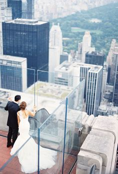 """Brides.com: Our Favorite Wedding Photographers Choose Their Best Shots. """"I love this photograph, because in a city of eight million people, with infinite possibilities, these two managed to find each other. At such a busy location like the Empire State building, they still look like they have the city and their futures to themselves. It shows how unique finding 'the one' really is!"""" — Jen Huang, Jen Huang Photography"""