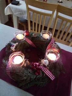 Advent wreath with buttons,jingle bell,wooden horse,ceramic bird,red and white ribbon and crystal glass candle holders