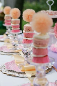 How cute is this for a tutu themed party or any girly event.  Cupcakes stacked on a crystal candle stand and held securely together by a skewer with a tulle puff glued on top - Love it!
