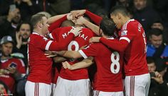Martial is swamped by his United team-mates